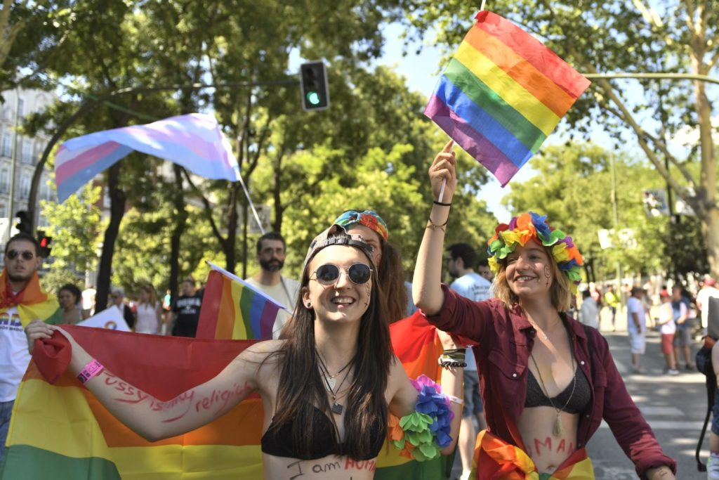 Participants wave Rainbow Flags as they take part in the WorldPride 2017 parade in Madrid