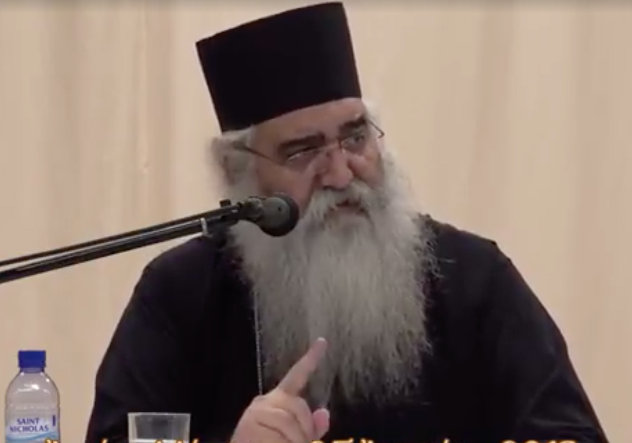 Bishop Neophytos of Morphou speaking into a microphone