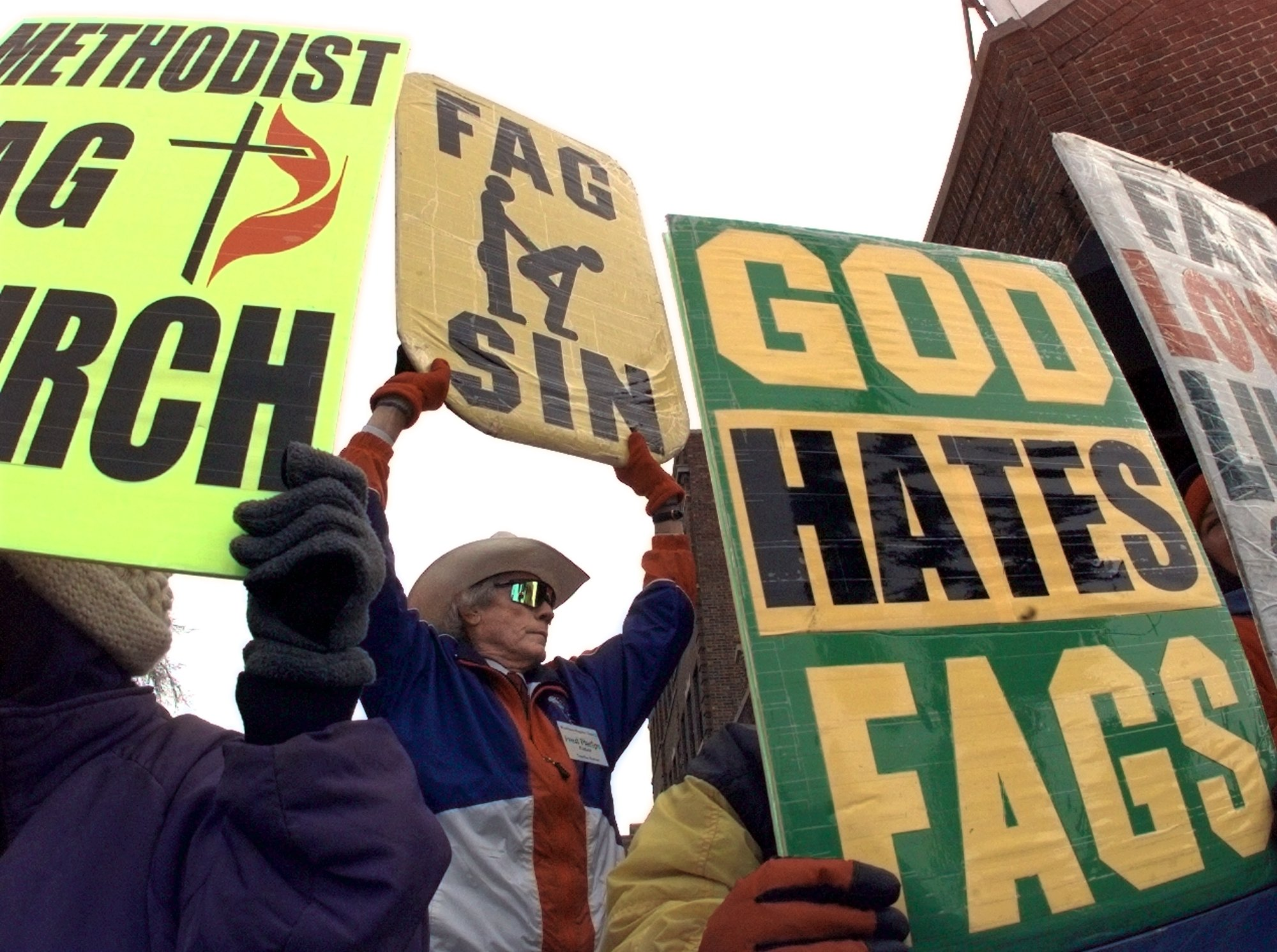 Rev. Fred Phelps from the Westboro Baptist Church of Topeka, Kansas holds a 'God Hates Fags' sign