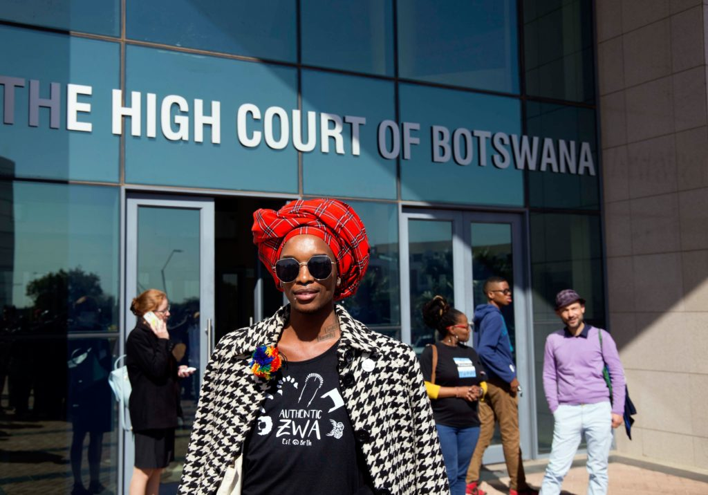 An activist poses for the camera outside Botswana High Court in Gaborone on June 11, 2019 after a ruling decriminalising homosexuality