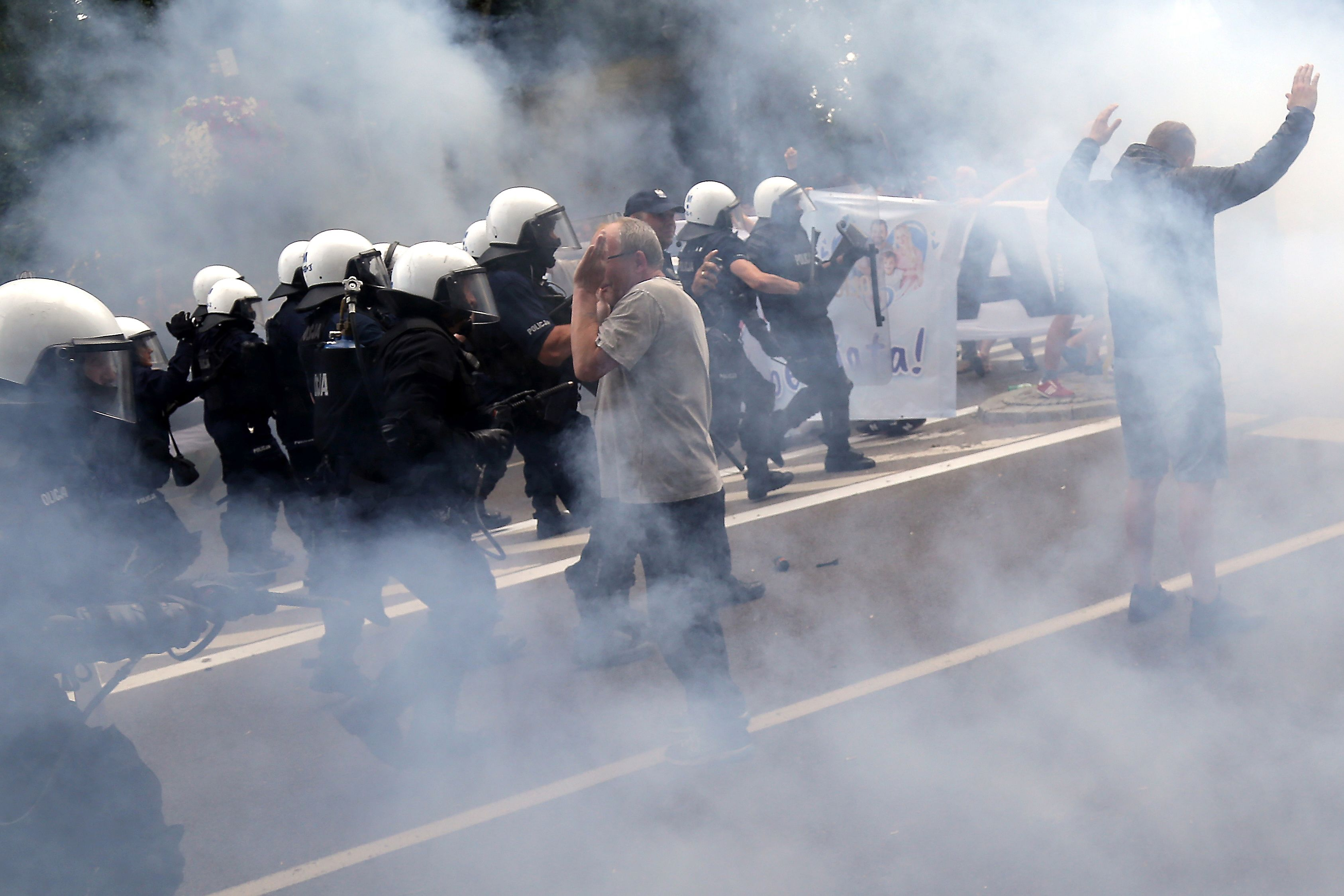 Riot police fire tear gas to disperse people, including ultra-nationalists, who attempted to block the first gay pride march on July 20, 2019 in Bialystok, eastern Poland