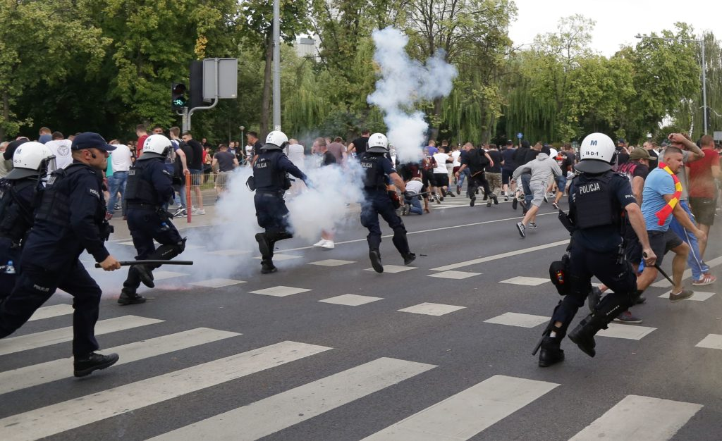 Riot police fire tear gas to disperse people, including ultra-nationalists, who attempted to block the pride march