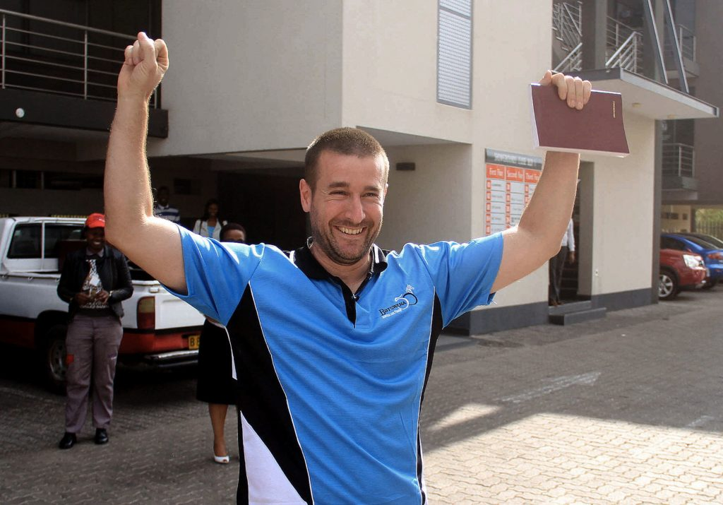 Controversial US pastor Steven Anderson reacts as he leaves the Botswana Department of immigration after being issued a deportation order by Botswana authorities, on September 20, 2016.