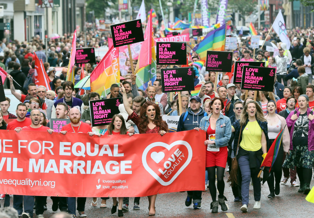 Equal rights campaigners take part in a march through Belfast on July 1, 2017 to protest against the ban on same-sex marriage.