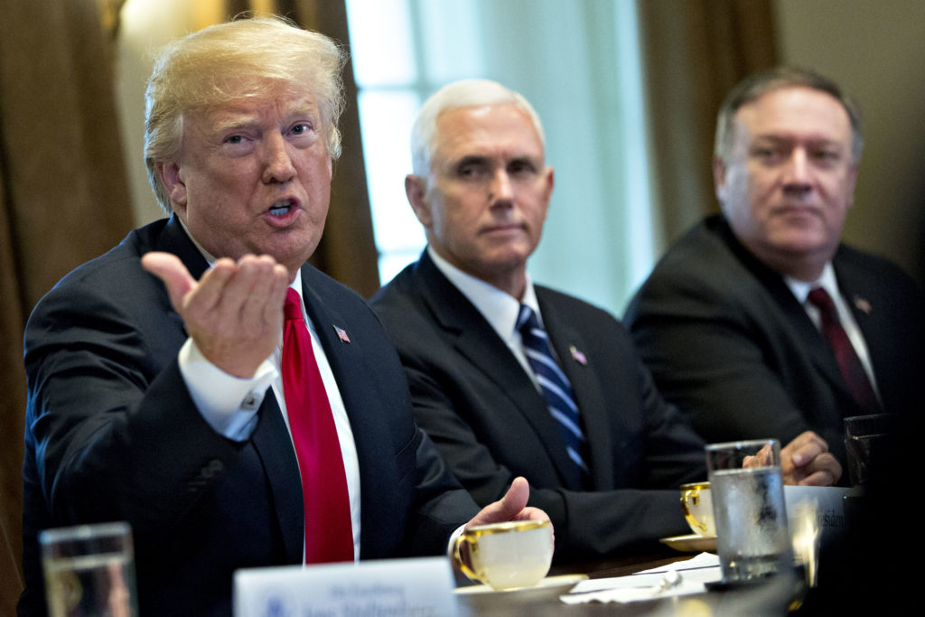 President Donald Trump speaks alongside Vice President Mike Pence and Secretary of State Mike Pompeo