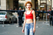 Carissa Pinkston wearing a red bra top and jeans