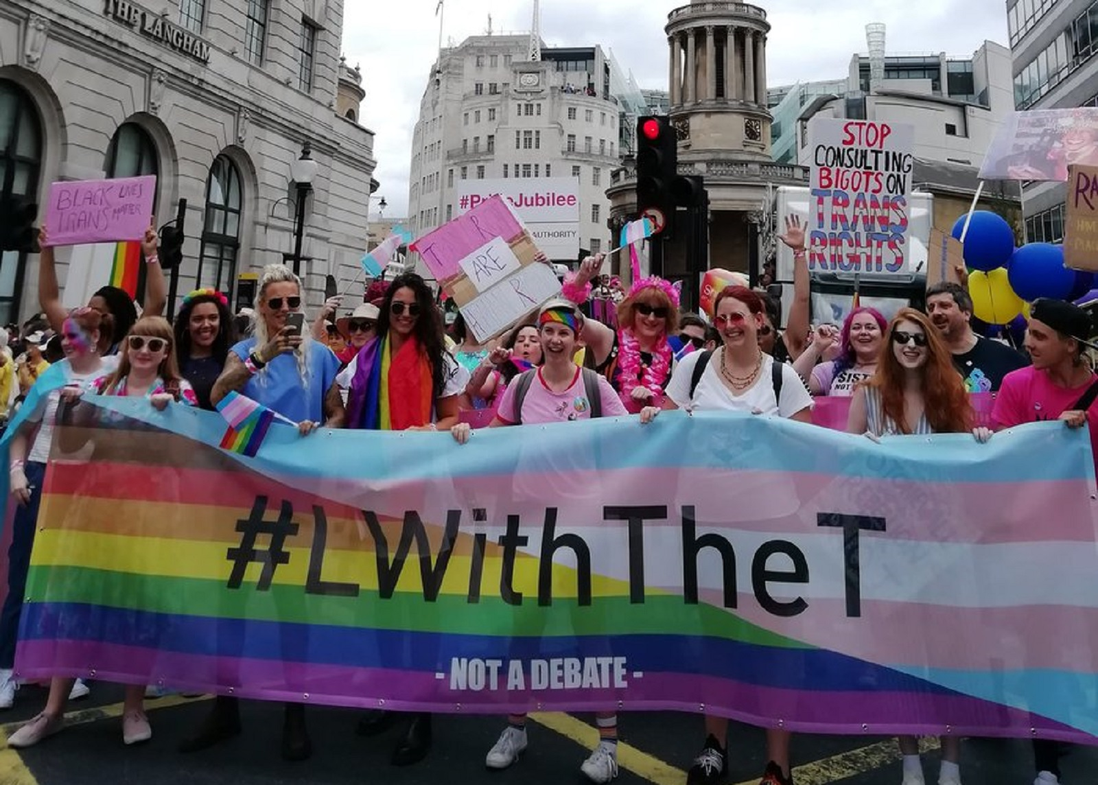 L with the T protesters lead the Pride in London parade