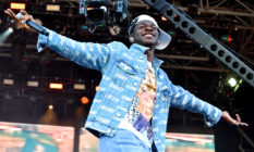 Lil Nas X on the Pyramid stage with his arms spread