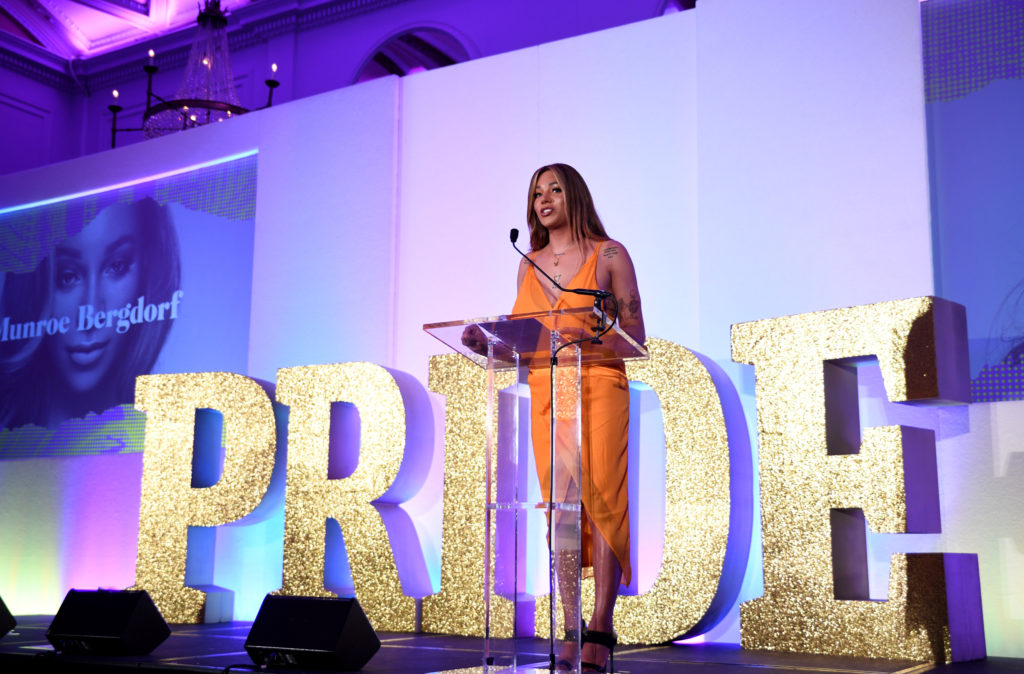 Munroe Bergdorf speaking in front of life-size Pride letters