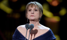 Patti Lupone behind a microphone