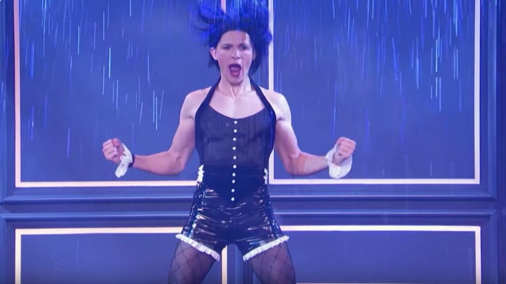 Tom Holland as Rihanna in a corset and shorts