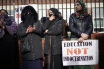 Parents, children and protesters demonstrate against the 'No Outsiders' programme, which teaches children about LGBT rights, at Parkfield Community School on March 21, 2019 in Birmingham, England.