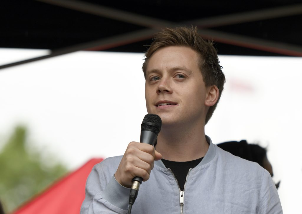 Guardian columnist Owen Jones speaks to the crowd during an Anti-Trump protest in London.