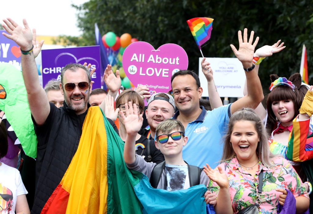 Ireland's Taoiseach Leo Varadkar (CR) joins members of the LGBT+ community and supporters as they take part in the Belfast Pride Parade 2019 in Belfast, Northern Ireland on August 3, 2019.
