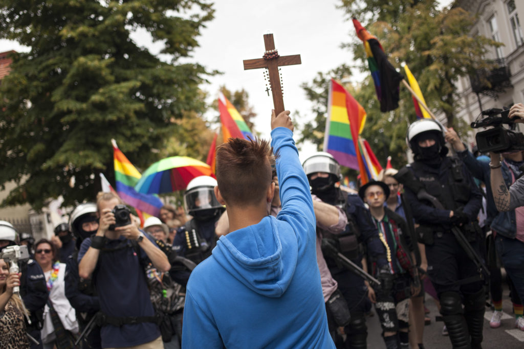 Poland plock equality parade blocked by teenager with crucifix