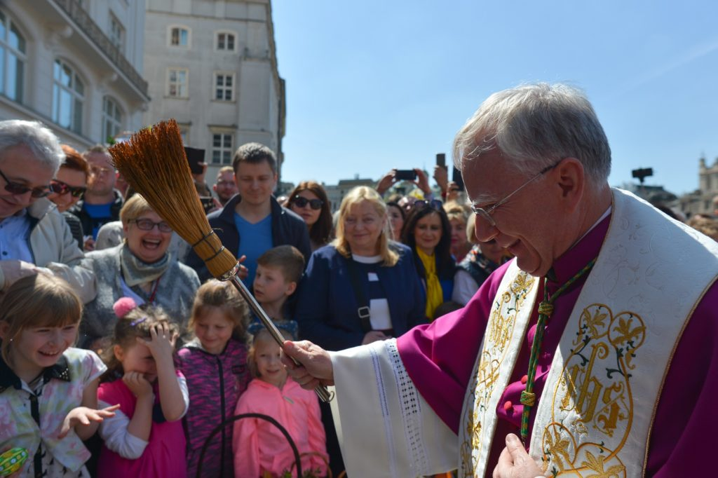 Baskets containing a sampling of Easter food are brought outside Mariacki Basilica in Krakow are blessed on Holy Saturday by the Archbishop of Krakow, Marek Jedraszewski.