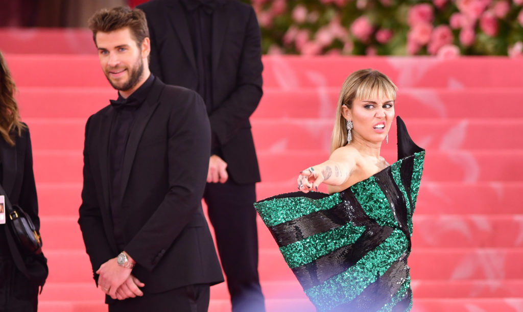 Liam Hemsworth and Miley Cyrus arrive to The 2019 Met Gala Celebrating Camp: Notes on Fashion at Metropolitan Museum of Art on May 6, 2019 in New York City.