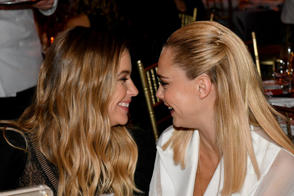 Cara Delevingne and Ashley Benson facing each other, smiling