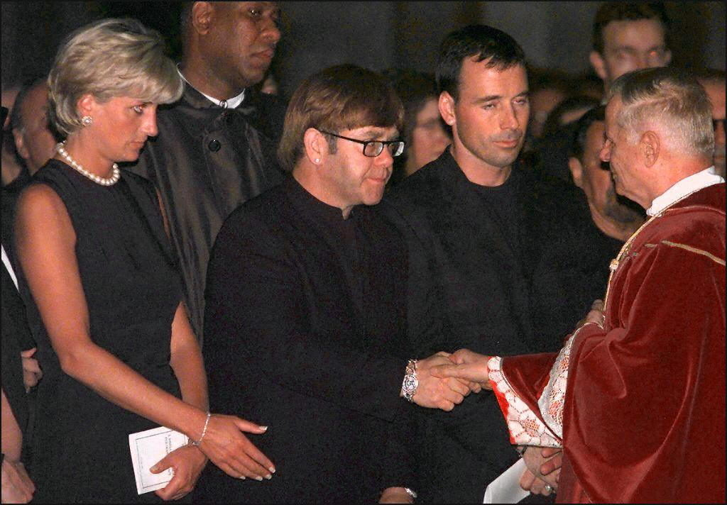 Elton John and Princess Diana at a service for the late Gianni Versace.