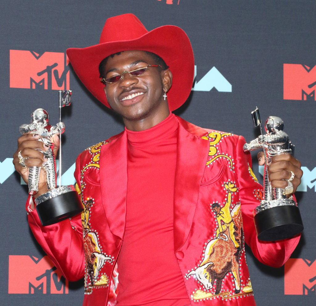 Lil Nas X holding his VMA Awards