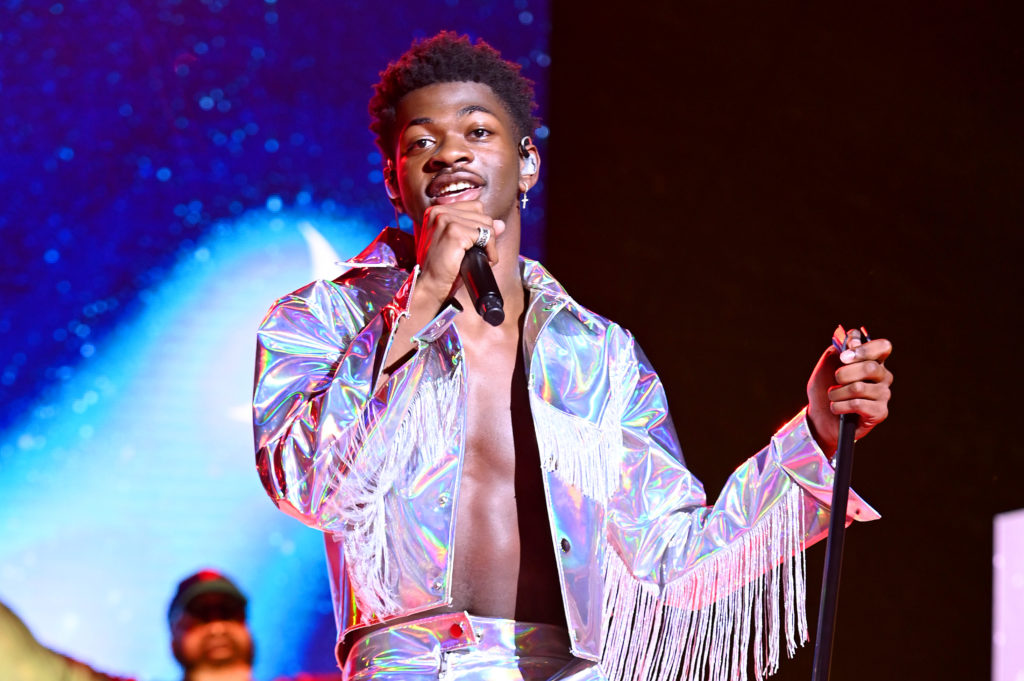 Lil Nas X in a silver fringed jacket