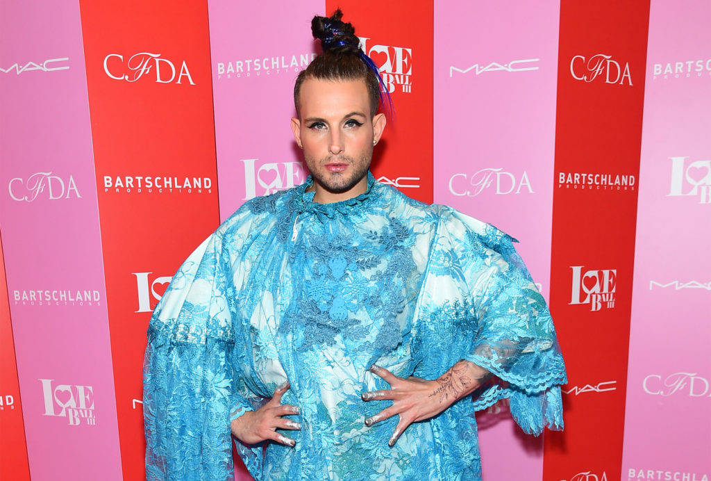 Nico Tortorella in a blue dress
