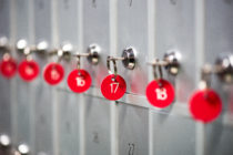 A close-up of grey metal lockers with red key numbers