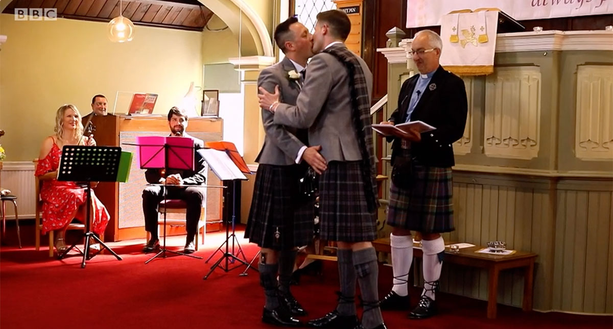 Jamie Wallace and Ian McDowall kissing at the altar