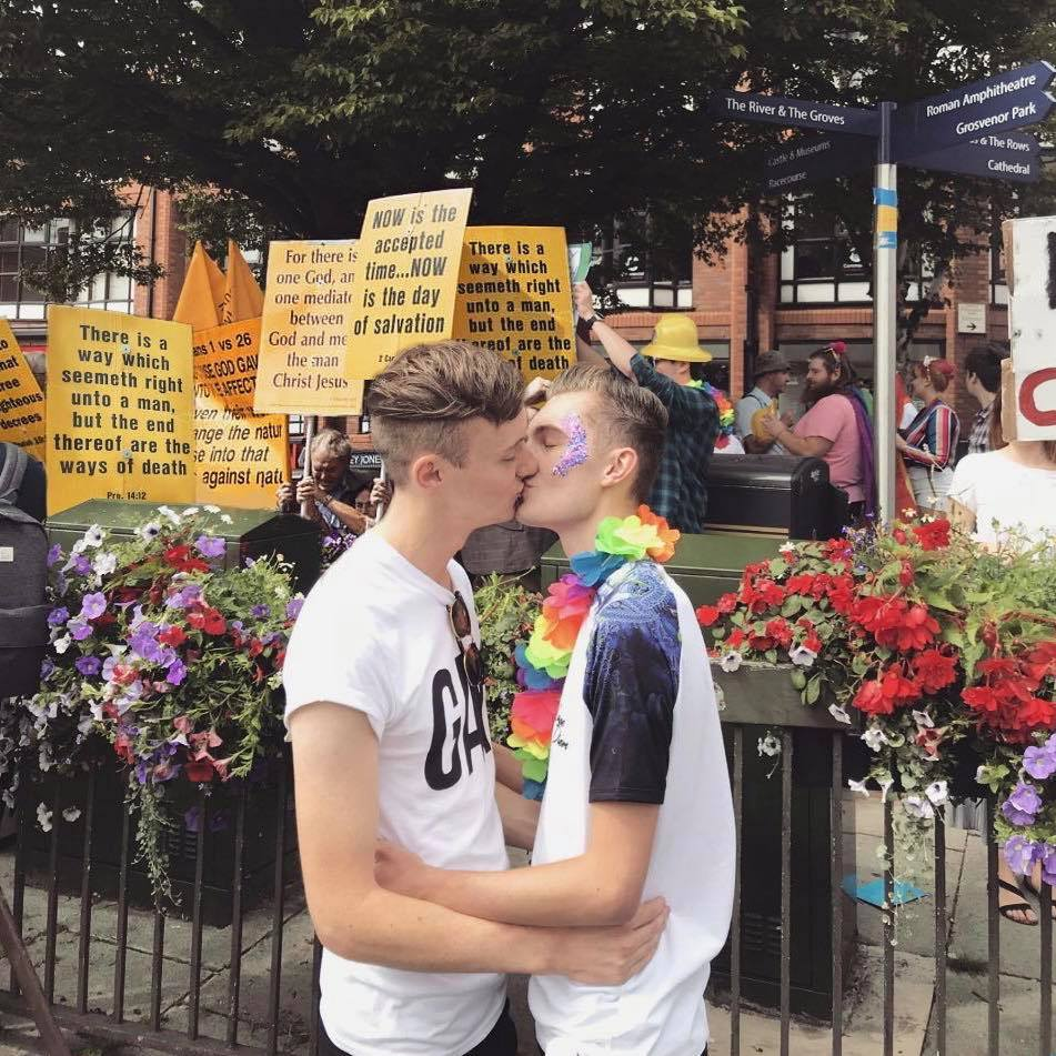 Gay couple has perfect response to protesters at Rocky Horror Show