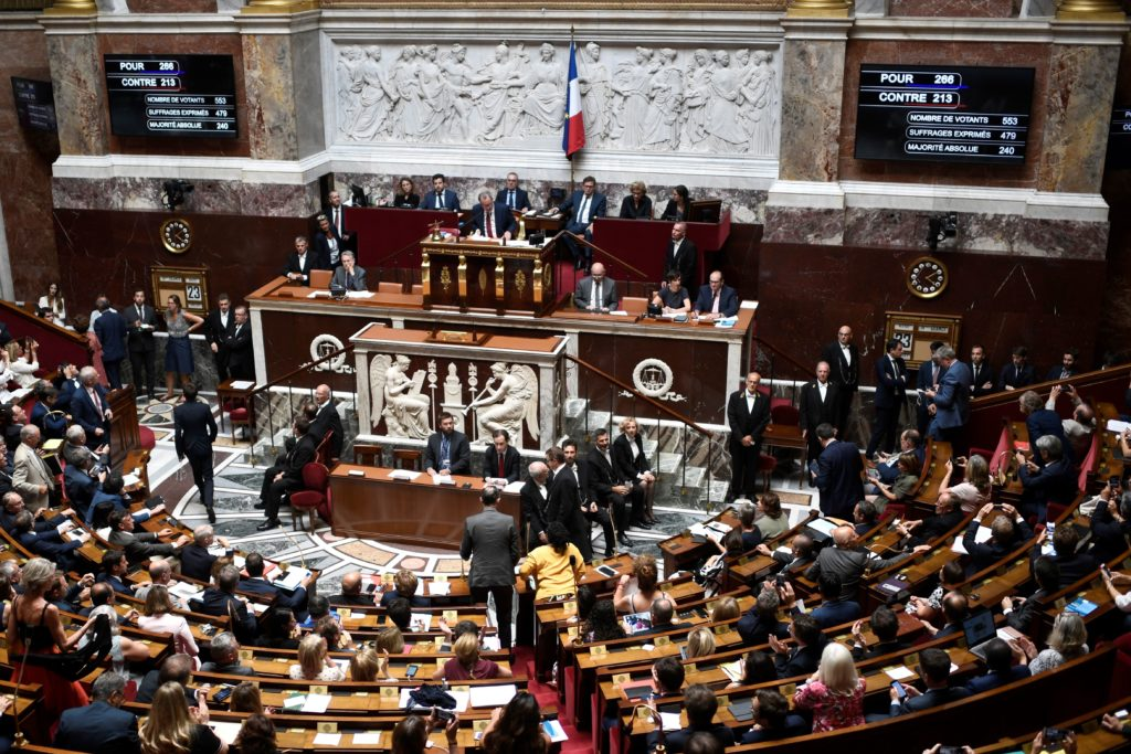 French Members of Parliament leave the National Assembly after a vote. File photo.