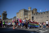 Cardiff, Wales, UK, August 24th 2019. The head of the Welsh parade passes Cardiff Castle during the Pride Cymru parade as part of a weekend of celebrations on the 20th anniversary of the event. (Photo credit should read Mark Hawkins/Composed Images / Barcroft Media via Getty Images)