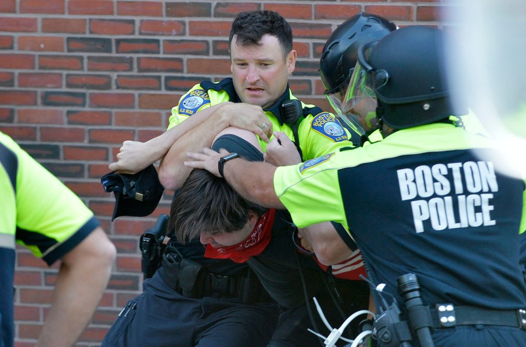 """Boston Police officers arrest an anti-parade demonstrator during the """"Straight Pride"""" parade in Boston, on August 31, 2019."""