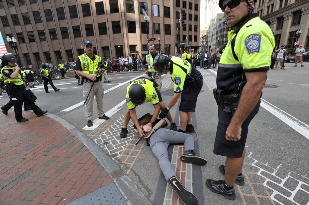 "Boston Police officers arrest an anti-parade demonstrator during the ""Straight Pride"" parade in Boston, on August 31, 2019."