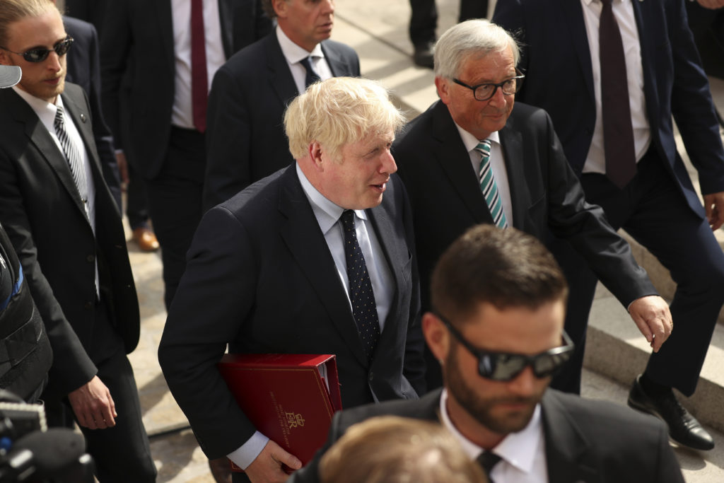 European Commission President Jean-Claude Juncker (R) poses with British Prime Minister Boris Johnson prior to a meeting at a restaurant. (Francisco Seco - Pool/Getty Images)