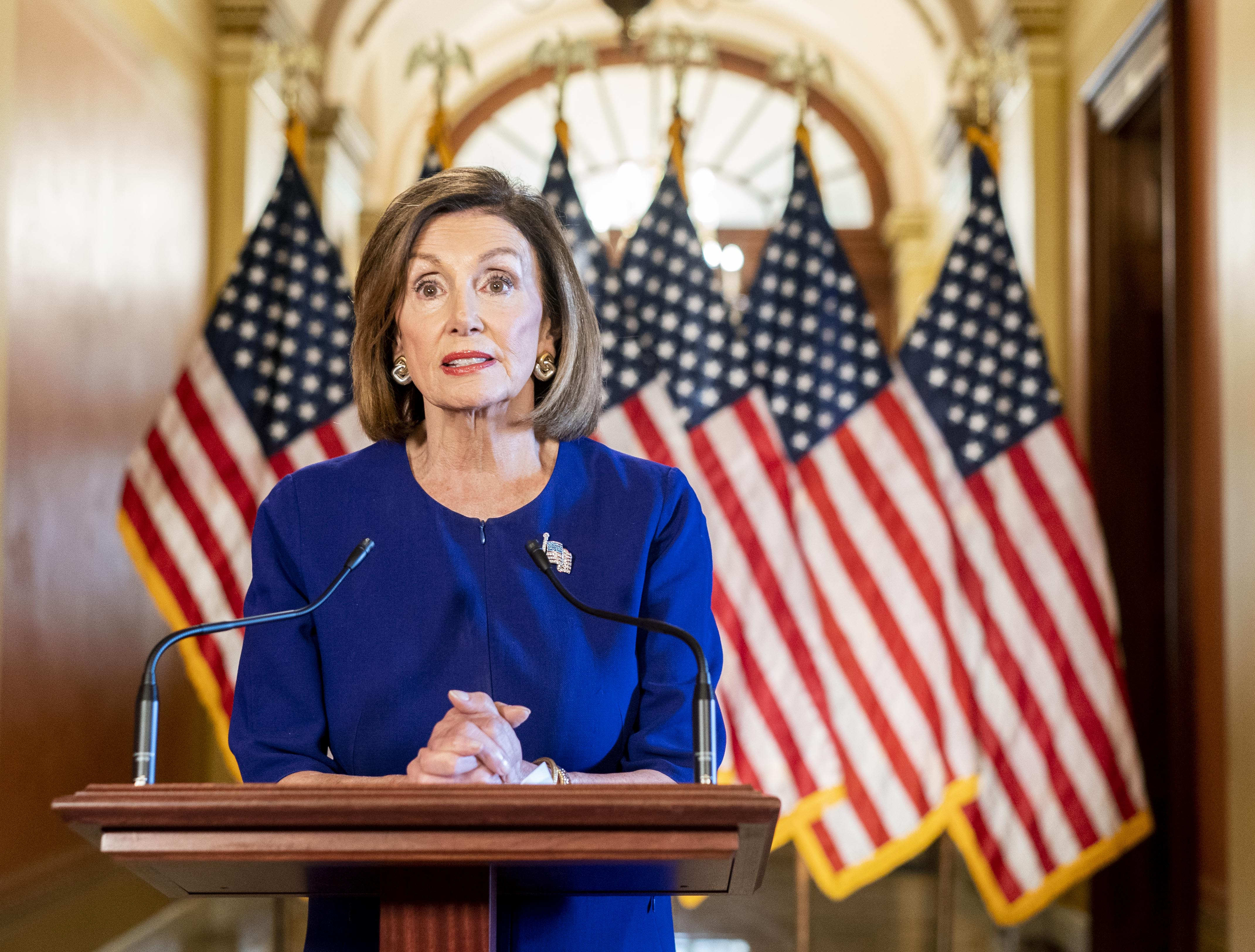 Nancy Pelosi delivers a speech concerning a formal impeachment inquiry into President Donald Trump. (Melina Mara/The Washington Post via Getty Images)