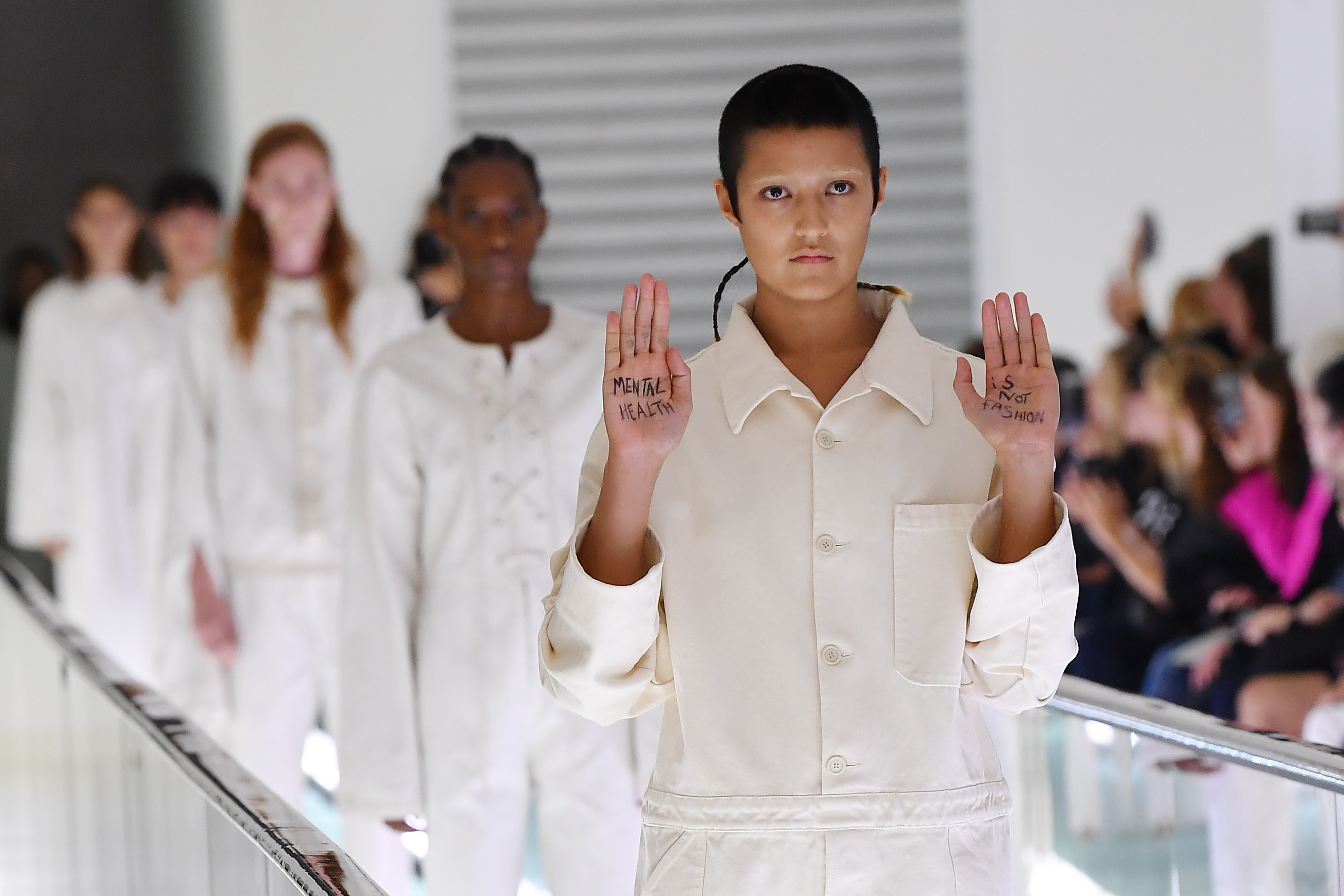 Non-binary model Ayesha Tan Jones protested mid-catwalk against Italian fashion house Gucci's use of straight jackets in its SS20 collection. (Jacopo Raule/Getty Images for Gucci)