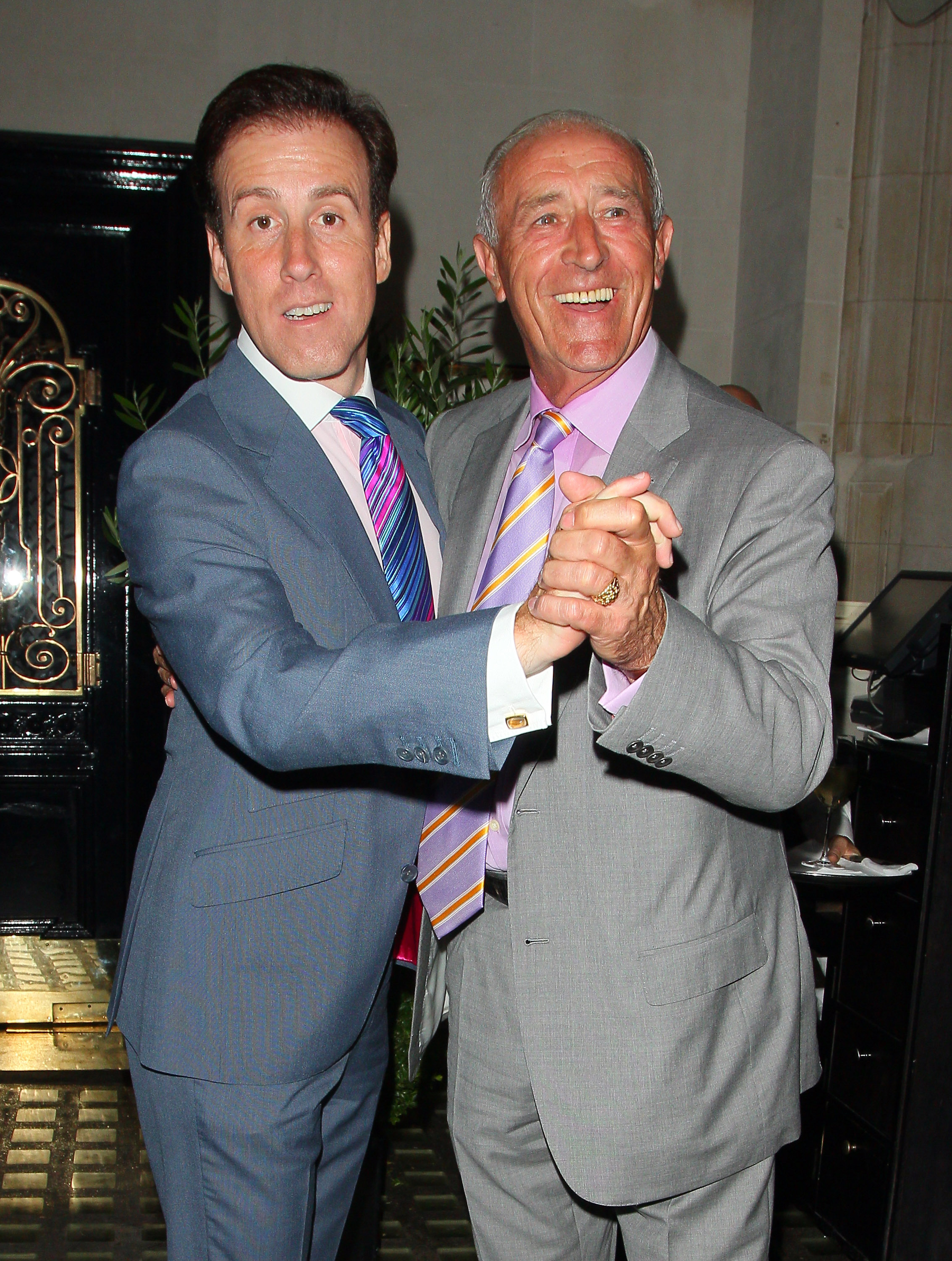 Len Goodman dances with a man Strictly