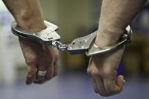 A prisoner's hands in handcuffs