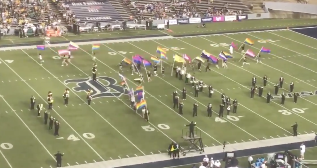 Marching band members at Rice University take to the stadium field raising and waving Pride flags. (Screen capture via Twitter/@ricemob)