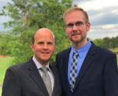 Joshua Payne-Elliott (right) and his husband, Layton Payne-Elliott, were both employed as Catholic school teachers before Joshua was fired.