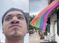 A man video himself spitting at an LGBT+ Pride flag in New York City. (Screen captures via YouTube)