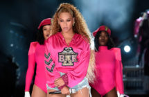 Beyoncé and two dancers in pink hoodies