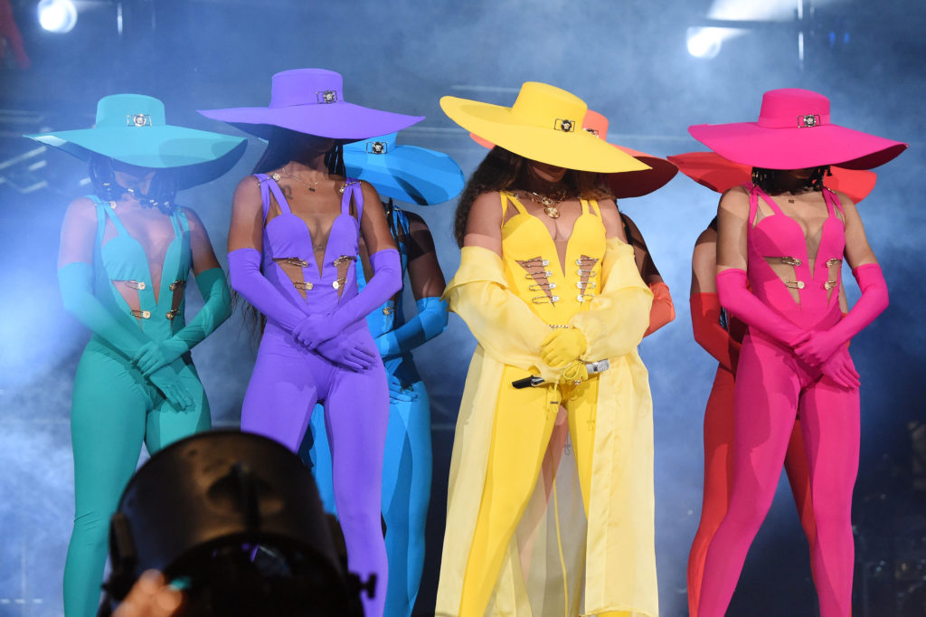 Beyonce and her dancers, each is wearing a colour of the pride flag