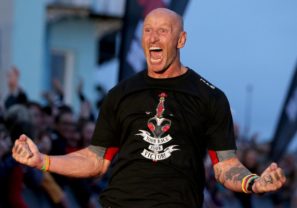 Gareth Thomas with cheering with his arms outstretched