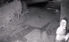 A still from the CCTV footage showing Parsons holding a can of spray paint