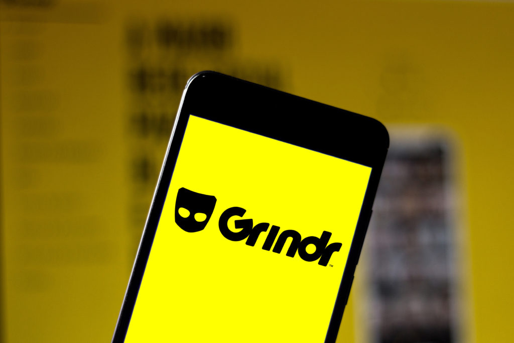 An iPhone with a Grindr splash screen