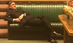 Jacob Rees-Mogg reclining in parliament