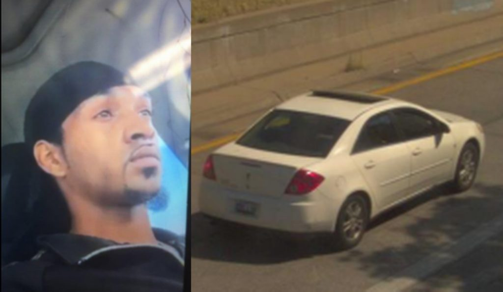 A photo of a man distributed by investigations in connection to the homicide alongside a car. (Kansas City police department)