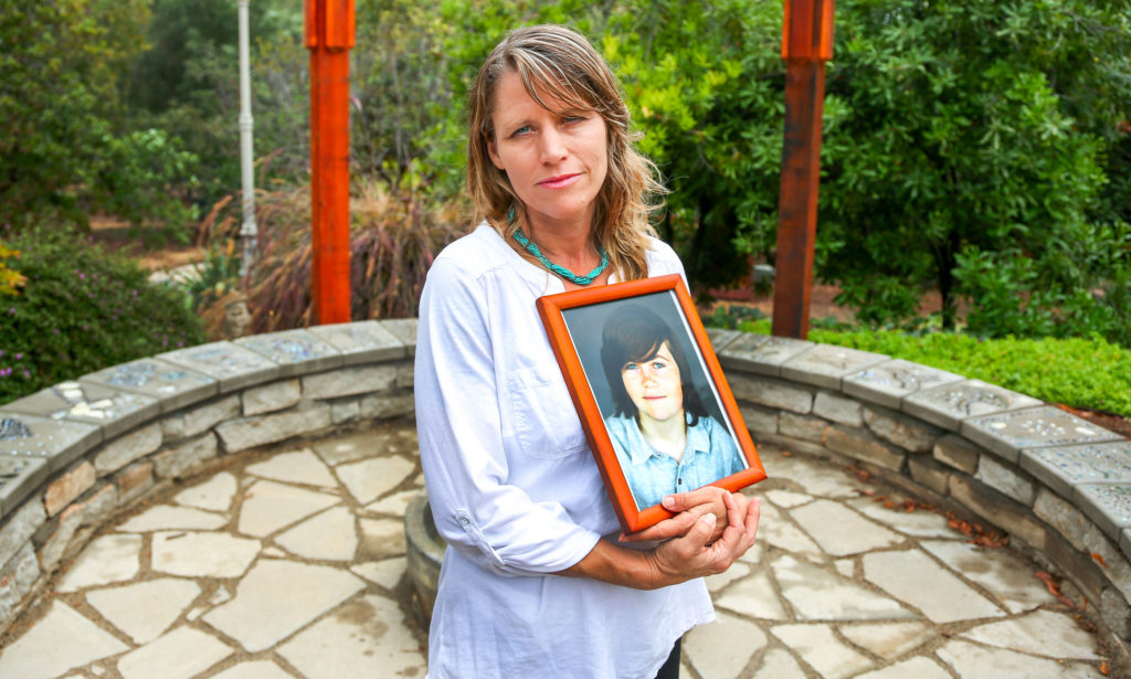 Katharin Prescott holding a photo of her son Kyler