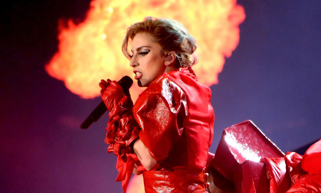 Lady Gaga in red leather infront of a column of flames